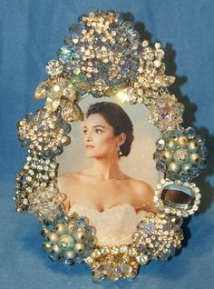 Great idea to bejewel a mirror with vintage jewelry
