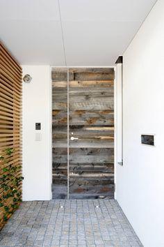 Amazing front door full of character of reclaimed wood.