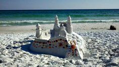 An architectural masterpiece, this shell-trimmed sandcastle was photographed on the beach near Silver Shells Resort.
