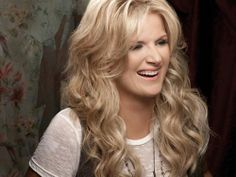 """""""Trisha"""" Yearwood(1964-)is a very successful American singer, author and actress. She has no children of her own and is step-mother to her husband Garth Brooks' 3 daughters."""