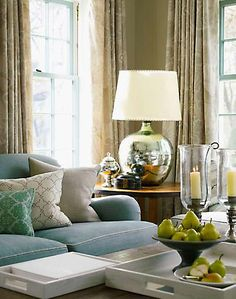 Reflective accessories like this beautiful lamp are fantastic ways to trick the eye in small spaces.