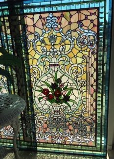 """Victorian style stained glassed windows. The most beautiful way to have privacy and lots of light. Vase of flowers surrounded by baroque curls and festoons. Beveled pieces and jewels give the windows extra dazzle. Ready to be hung or framed. All hand made. 40"""" x 60""""  six available."""