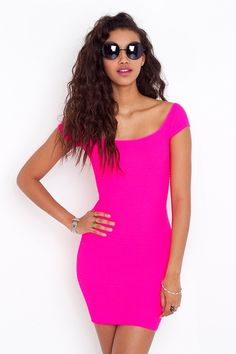 neon pink dress. Plain but sexy. Would make me look sooooo tan in the summer :)