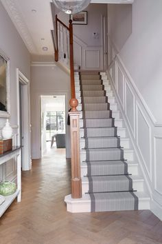 Black And White Striped Carpet Runner On Landing Stairs