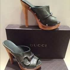 💢Gucci Python clogs💢 💢Gorgeous python wooden clogs. Limited eddition . Silver studs going all around . Huge Gucci buckle in the front of the shoe. Says size 8.5 but I am a size 9 and they fit me perfectly . Color of the Python skin is gorgeous --very dark hunter green with brown. In great condition wore them once💢 Gucci Shoes Mules & Clogs