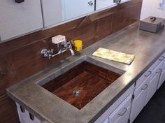 Solid wood sink with an epoxy and marine varnish to keep it protected