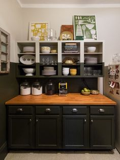 We love this two-tone kitchen with open shelving & butcher block counters