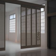 Moveable curtain panel walls - we like the pierced screen and how it floats off ground - could be good for more public areas vs solid panels for more private areas. Curtain Divider, Room Divider Doors, Curtain Panels, Corporate Interiors, Office Interiors, Partition Screen, Movable Walls, Casa Loft, Sliding Wall