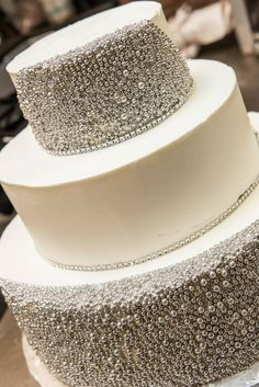 A lovely Colorado wedding cake by Piece, Love & Chocolate, encrusted with edible silver droplets! #wedding #weddingcake #dessert #weddinginspiration  #whitechocolate #silver #sparkle #elegant