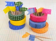 Toothpick flags made with colored tape.  Label appetizer dishes or stick in cupcakes for decoration.