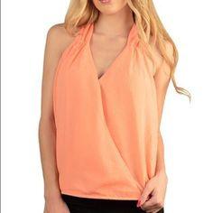 Orange v neck top Brand new. Sleeveless orange v neck floral embossed pattern top. Fits true to size. 100% polyester. Boutique Tops Blouses
