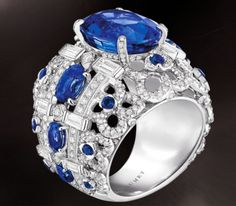 CHAUMET HORTENSIA RING  in white gold, diamonds, sapphires, set with an oval-cut sapphire.