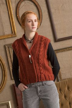 Cables flanked with garter stitch adorn this open front vest. Knit in Toboggan.