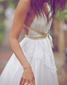 .gorgeous boho chic wedding dress look | lacey top | full flowy skirt | gold champagne colored criss-cross sash in front