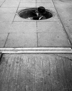 Erika Stone-In the Manhole, New York, 1970's. http://www.erikastone.com/