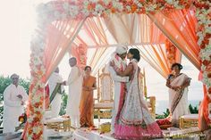 Love this mandap. Would want this but fewer flowers - thinner ones just at the top maybe and at the ties (not on every post, and not vertical). Top flowers can also be reduced. Also more greenery. Indian Wedding Receptions, Indian Wedding Ceremony, India Wedding, Indian Wedding Planning, Wedding Mandap, Temple Wedding, Indian Wedding Decorations, Wedding Stage, Dream Wedding