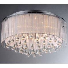 Add some elegance to your home with this Demeter Chrome Chandelier. This dynamic lighting element features generous rows of cascading crystals to catch the light.