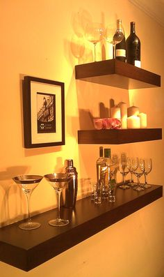 AWESOME idea for a bar.  I saw shelves like these at Bed Bath & Beyond.  Also clears space in my cabinets where all of the glasses are now!