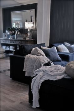 Love the navy couches. Family room ideas for a navy black and grey color scheme. What do you think? Also love the grey sweater throws for winter time!