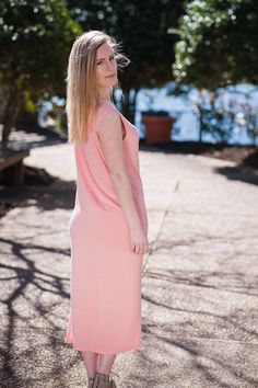 You'll be feeling Peachy Keen in this ultra comfortable sleeveless midi dress. This scoop neck wonderfeatures a bottom side slit and comes in a gorgeous spring