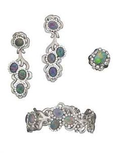 A SET OF BLACK OPAL DOUBLET, BLACK OPAL AND DIAMOND JEWELLERY  Comprising a bangle, of scrolling design, the textured gold bangle set with oval-shaped black opal doublets, within diamond-set surrounds; and a pair of black opal doublet ear pendants and a black opal ring en suite, mounted in 18k white gold.