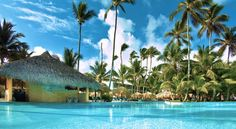 The Grand #Palladium Palace #Resort Spa & Casino is located on the seashore of famous #Bavaro Beach in Punta Cana. Its exotic landscape features a lush palm tree plantation, beautiful tropical plants, and a long beach with fine white sand and pristine turquoise waters. #allinclusive #hotel #puntacana