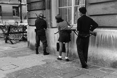 A very famous scene as seen from a different angle. 18 year old French Resistance fighter Simone Segouin (aka Nicole Minet), along with two other resistants, take care in order to avoid German snipers on the streets of Paris. She is armed with her trusty captured MP40 sub machine gun.