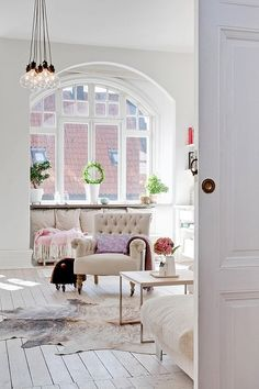 Love a light-filed room...beautiful arched window.