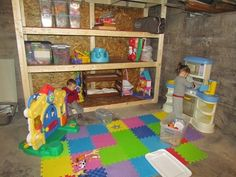 Kids playroom (+laundry) in an unfinished basement