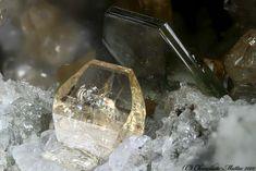 Humite Monte Somma, Somma-Vesuvius Complex, Naples Province, Campania, Italy 1.81 mm orangle-pale Humite crystal VS69bMini.jpg