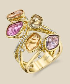 BD3751A by Parade Design. A scattering of bezel set pastel natural tumbled sapphires in 18K yellow gold nestled within brilliant white diamonds and gleaming high-polished gold.