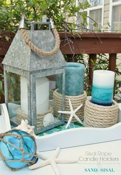 DIY Sisal Rope Candle Holders - These are so simple and inexpensive to make and won't damage your candles. Perfect coastal decor for summer!