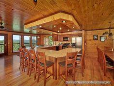 "kitchen/dining area in ""Smokies Tower,"" a 6 bedroom luxury rental cabin in Gatlinburg"