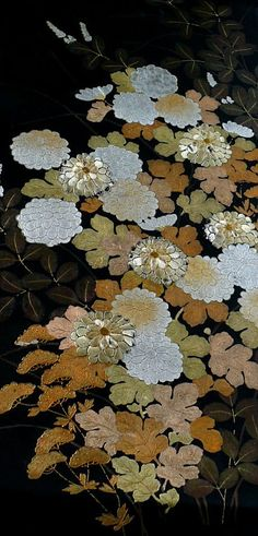japanese traditional 'fukuro' obi belt. Lavish use of gold and silver threads in hand embroidered and painted chrysanthemum flowers and golden leaf motif. 1930s, silk brocaide.  Frequently these obi were more expensive than the kimonos they adorned.