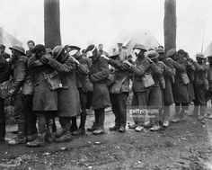 Chemical Warfare In The Twentieth Century, British troops blinded by tear gas wait outside an Advance Dressing Station, near Bethune, 10 April 1918. An image reminiscent of John Singer Sargent's famous painting 'Gassed', 10 April 1918.