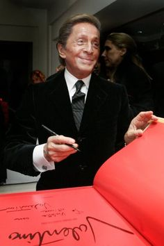 Valentino and his classic red.. *to remember: reading books by designers are so empowering- they understand women on a different level