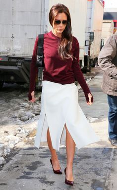 Fall Vibes from Victoria Beckham's Street Style  The street style star slipsinto a burgundy sweater styled with a long white skirt while out and about.