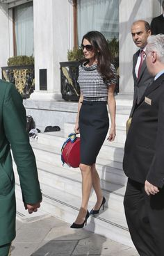 The classic hat-box bag looks brand-new in the hands of Amal Clooney.