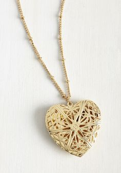 Relishing Recollections Necklace. Whether youre admiring the photo youve placed in this heart-shaped locket or simply reveling in its vintage-inspired style, this ModCloth exclusive will warm you to the core. #gold #modcloth