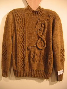 Braga - the Dragon Runes sweater on the Rainey Sisters blog. No pattern, unfortunately.
