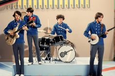 """Davy Jones, Micky Dolenz, Peter Tork and Mike Nesmith perform """"What am I Doing Hangin' 'Round"""" on the set of  The Monkees episode """"A Nice Place to Visit"""" in August 1967."""