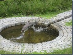 Rill garden.  Try cobbles and water channel around a millstone?