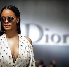 Rihanna leads the glamour in a bee-embroidered plunging white gown as she attends the Dior SS17 show for Paris Fashion Week | Daily Mail Online