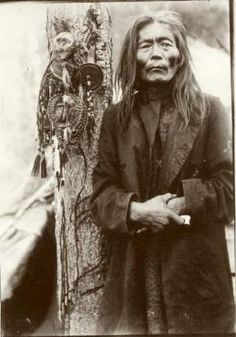 Evenk shaman with a collection of shamanic objects,   including images of helper spirits, early 1900s.   No. 5659-120  (Russian Museum of Ethnography)