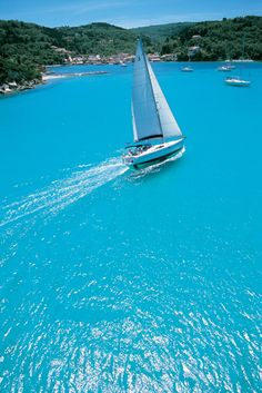 Sailing at Lakka bay, Paxos island, Greece. - Selected by www.oiamansion.com in Santorini.