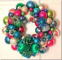From the wonderful.... Georgia Peachez...  http://www.georgiapeachezwreathblog.blogspot.com/   The vintage ornament wreath.... with blues and pinks