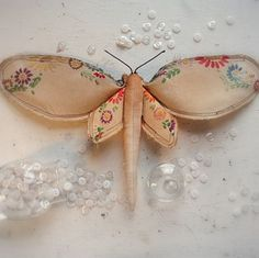 buttefly's made from vintage linens..would be cute made into a mobile or off a chandelier