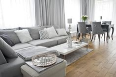 #Modern #Classic #House. The #living room in #gray and #white colors is timeless. Gray sofa, darker table in the dining room, gray chairs in the modern classic style. Everything decorated with soft pillows and glass candle holders and lamps. #ideas #desig
