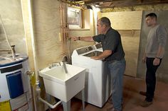 Ask This Old House plumbing and heating expert Richard Trethewey helps a homeowner install a washer and dryer in his basement.