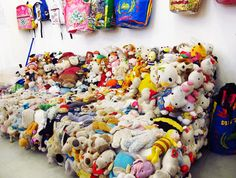 couch covered in vintage stuffed animals. I'm surprised my grandpa hasn't done this
